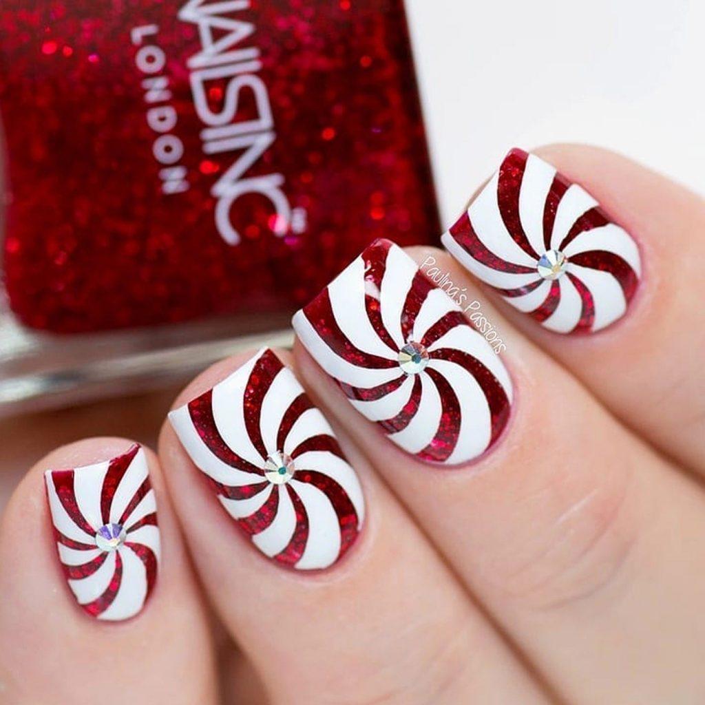 Candy cane swirl nail design