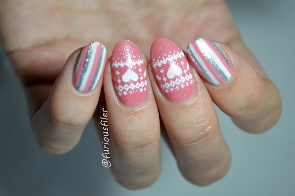 Pink hearts and white and silver wrapping paper nails